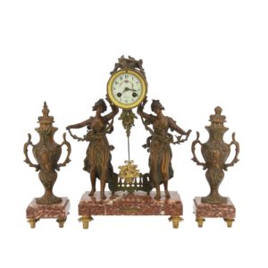 C.L. Fournier á AngoulêmeGarniture clock Les Fauvettes and two decorative vases 1