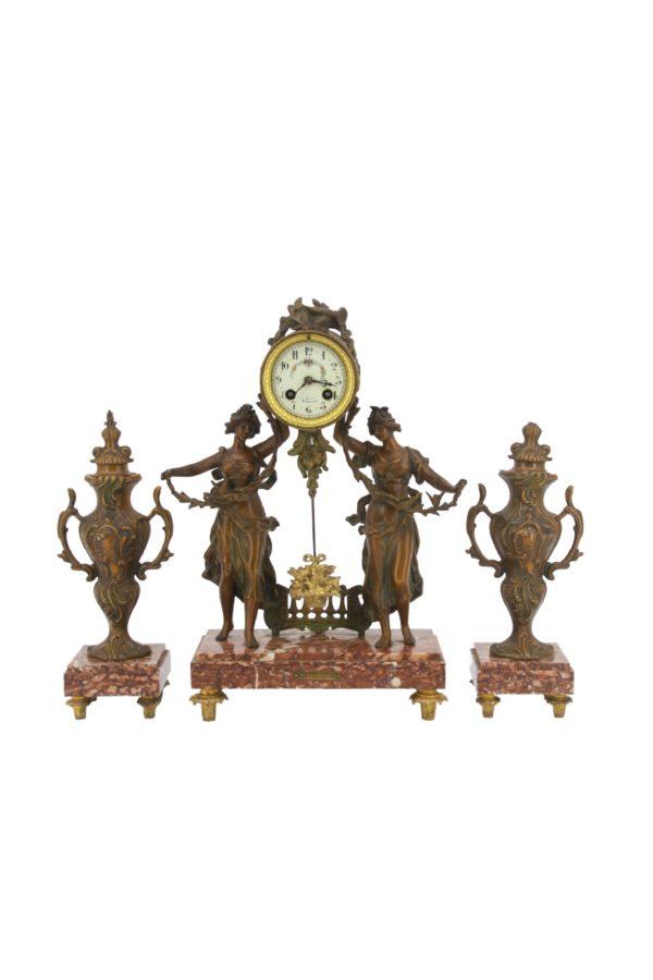 C.L. Fournier á AngoulêmeGarniture clock Les Fauvettes and two decorative vases 1